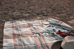 A party on the beach at sunset with wine. Romantic evening in the summer by the sea. Picnic. copy space.  stock photo