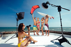Party on beach. Surfer and kiter boys with beautiful girls group have photoshooting on beach Stock Images
