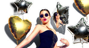 Party. Beauty model girl with colorful heart and star shaped balloons Royalty Free Stock Photography