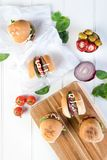 Party beef burgers sliders share. Small burger sliders for share mayo onion board sharing platter party food beer Stock Photography