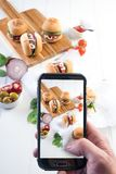 Party beef burgers sliders share. Small burger sliders for share mayo onion board sharing platter party food beer Stock Images
