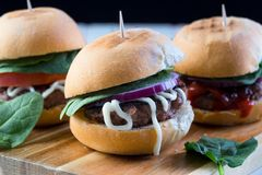 Party beef burgers sliders share. Small burger sliders for share mayo onion board sharing platter party food beer Stock Photos