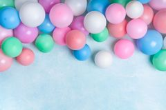 Party or birthday banner with colorful balloons on blue background top view. Flat lay style royalty free stock image