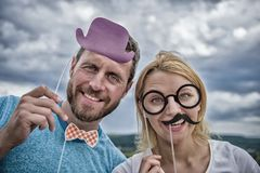 Party or Birthday concept. Young couple in a photo booth party w stock images