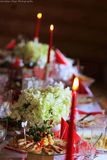 Party decorations on table. Party birthday table food dishes decorations candle candleholders cage food dishes royalty free stock photo