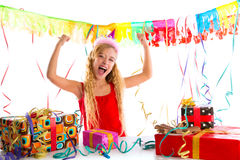 Party blond kid girl happy with many presents. Hands up excited Stock Photography