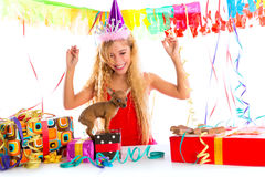 Party blond kid girl happy with puppy present Stock Photo