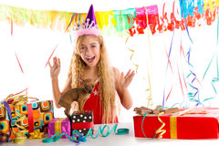 Party blond kid girl happy with puppy present Royalty Free Stock Photos