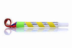 Party blower. Colorful party blower isolated on white background royalty free stock images