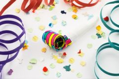 Party blower with confetti and Royalty Free Stock Photo