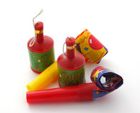Party blowers and poppers. On a plain white background Stock Image