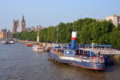 Party Boats Moored on The Embankment, London & Big Ben. Stock Photo