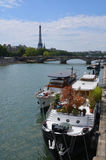 Party Boats Moored on The Seine River with Eiffel Tower in Backg Stock Photography