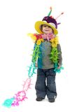 Party Boy. Smiling 5 year old boy with colorful boa around his neck, and an over-sized birthday hat on his head.  Taken in studio on isolated white background Stock Photography