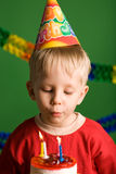 Party boy blowing birthday candles Stock Photos
