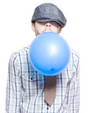 Party Boy Blowing Up New Years Eve Balloon Royalty Free Stock Images