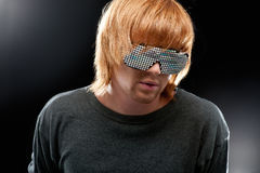 Party boy in club glasses stock image