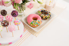 Party buffet. Donuts and cakepops on buffet at the party Stock Photos