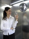Party Businesswoman. A businesswoman celebrating with a glass of champagne royalty free stock photos