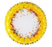 Party cake 2. Yellow icing on a white party cake with confetti candy Royalty Free Stock Photography