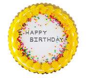 Party cake. Yellow icing on a white happy birthday party cake Royalty Free Stock Image
