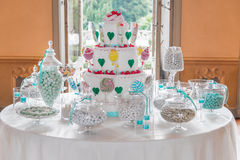 Party cake. Dessert table with cake and candy for a wedding or party royalty free stock photo