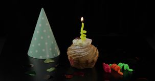Party. Cake and festive candle on it. Light the candle. Celebrate birthday. Party. Cake and a yellow festive candle on it. Light the candle and then blow it stock footage