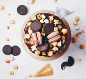 Party cake with macaroons and Popcorn, birthday concept. Top view, flat lay royalty free stock image