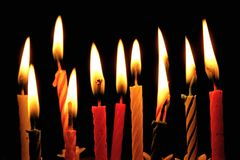 Party Candles. Different coloured lit party candles stock photography