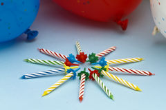Party Candles and Balloons. Striped birthday party candles and balloons Stock Image