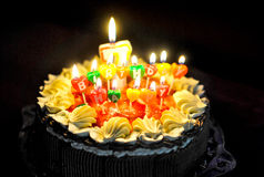 Party Candles on a  Birthday Cake Royalty Free Stock Photos