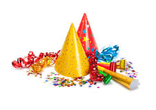 Party caps, confetti and streamers royalty free stock photos