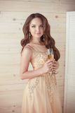 Party celebration, drinks. Beautiful elegant woman in evening dr Royalty Free Stock Image