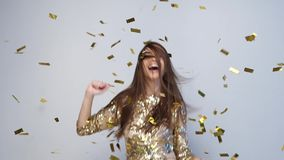 Party Celebration. Happy Woman Throwing Gold Confetti, Dancing stock video footage