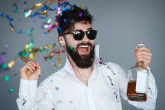 Party celebration young bearded man with confetti. Stock Photos