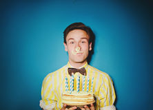 Party celebration with young man with a cake Royalty Free Stock Image