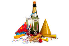 Party - champagne, caps, confetti and streamers Stock Photography