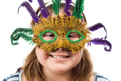 Party Child. Closeup of a party child wearing a feather mask, isolated against a white background Royalty Free Stock Photos