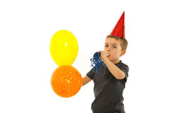 Party child boy with noise maker. And balloons isolated on white background stock images