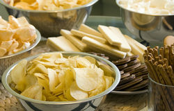 Party chips and crisps. Bowls of chips and crisps ready for a party royalty free stock photography