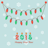 Party christmas light bulbs. Fairy party red and green christmas light bulbs, hanging on light green background with snowflakes and happy new year 2015 candles Stock Photo
