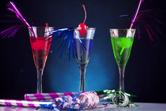 Party cocktails. Colourful holiday cocktails on a black and blue backgorund Royalty Free Stock Photos