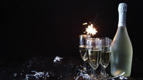 Party composition image. Glasses filled with champagne placed on black table stock footage