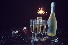 Party composition image. Glasses filled with champagne placed on black table royalty free stock image