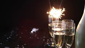Party composition image. Glasses filled with champagne placed on black table stock video footage
