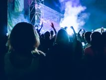 Crowd raising their hands and enjoying great festival party or concert. stock images