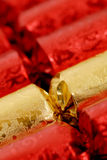 Party crackers. Close-up of red and golden party crackers Royalty Free Stock Images