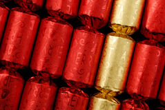 Party crackers. Close-up of red and golden party crackers Stock Photo