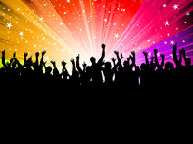 Party crowd. Silhouette of a crowd of party people on a starburst background Royalty Free Stock Image