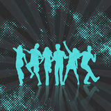 Party crowd on abstract dots background. Silhouettes of people dancing on a halftone dots background Royalty Free Stock Image